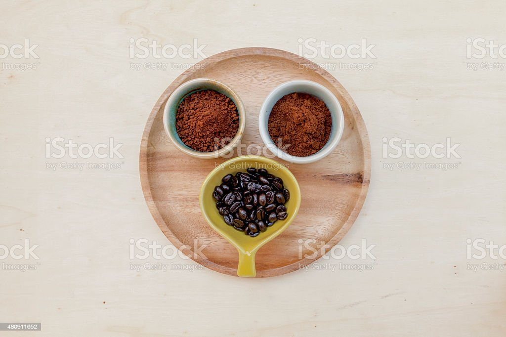 Coffee selections on wooden plate stock photo