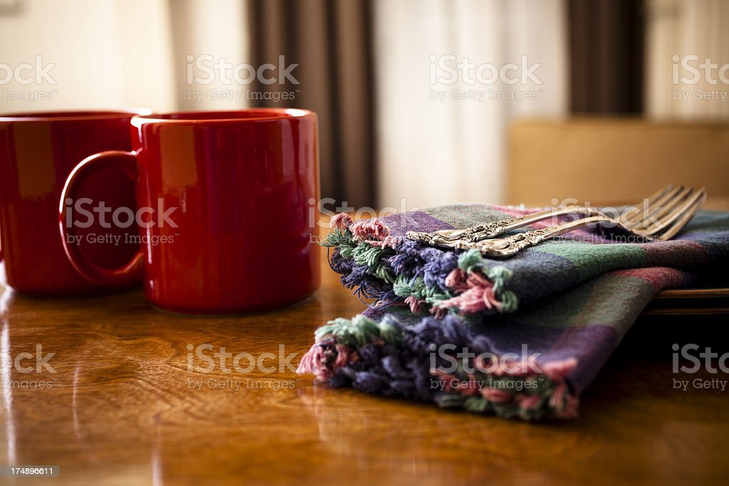Coffee set for two with red mugs cloth napkins forks royalty-free stock photo