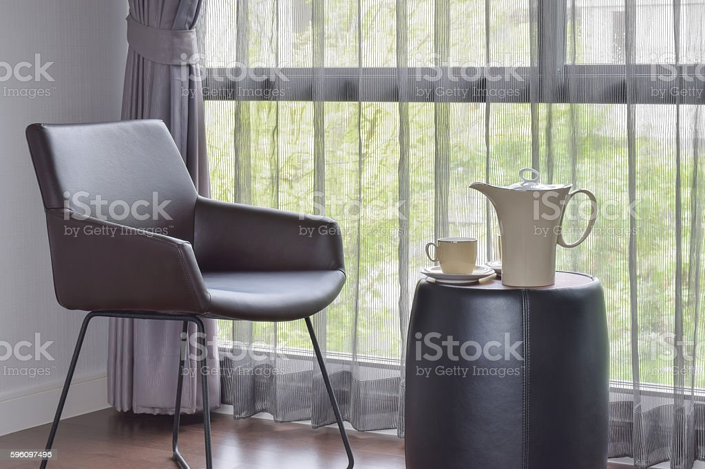 coffee set on table with leather chair in living room Lizenzfreies stock-foto