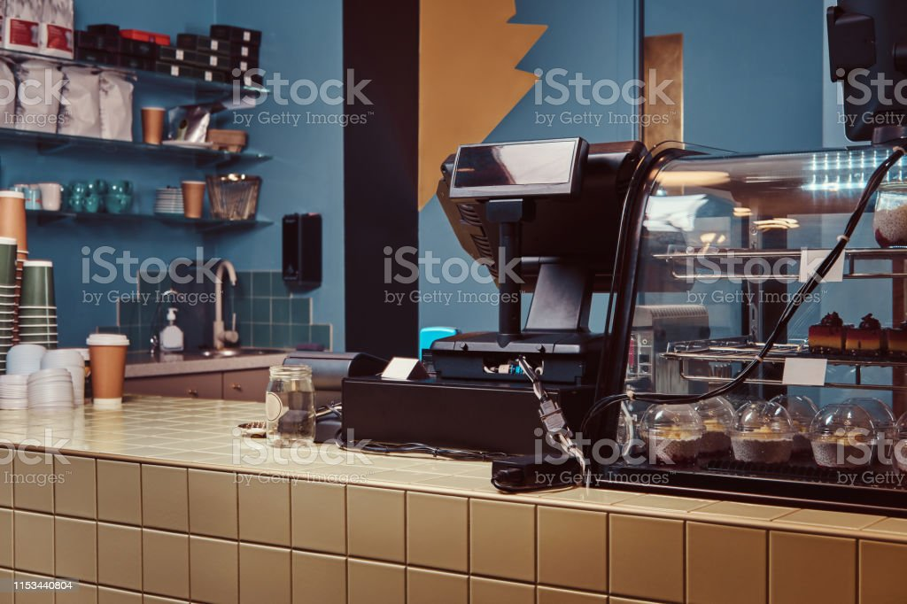 Cafe or coffee shop bar and counter with coffee equipment.