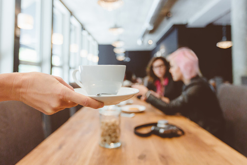 Coffee Shop Close Up Of Hand Holding Cup Of Coffee Stock Photo - Download Image Now