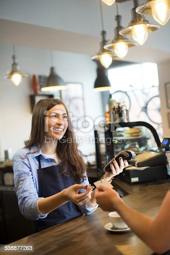 istock coffee shop credit card payment 538877263
