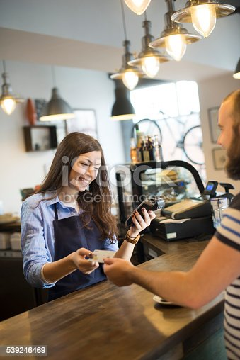 istock coffee shop credit card payment 539246469