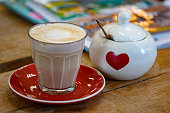 Coffee/ latte/ Cappuccino with heart-shaped sugar bowl.
