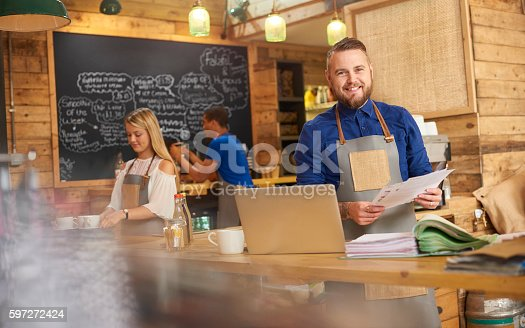 istock Coffee shop owner cash flow 597272424