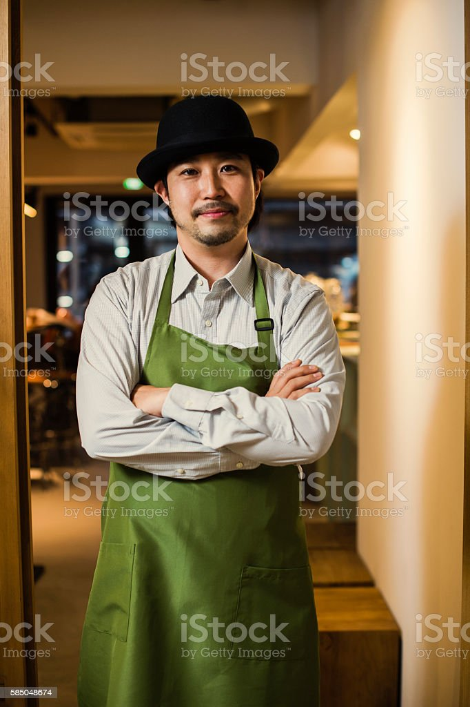 Coffee shop owner standing in front of the shop stock photo