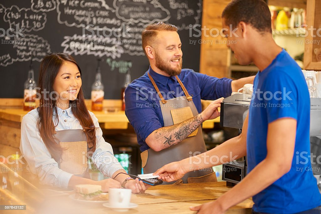 coffee shop payment stock photo