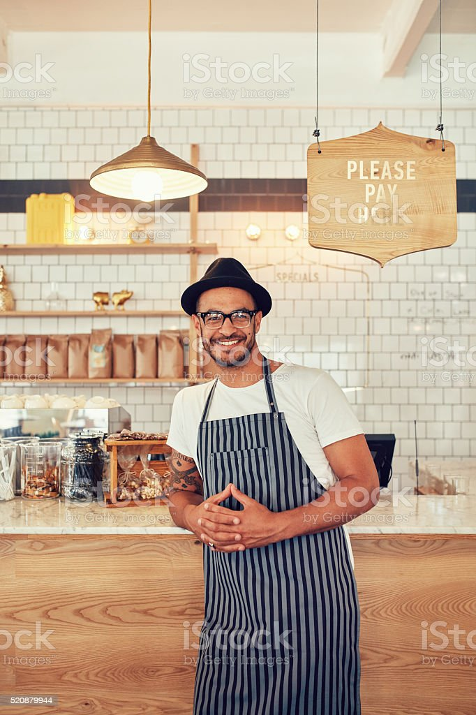 Coffee shop worker smiling to camera stock photo