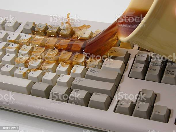 Coffee Spilled On Keyboard Stock Photo - Download Image Now