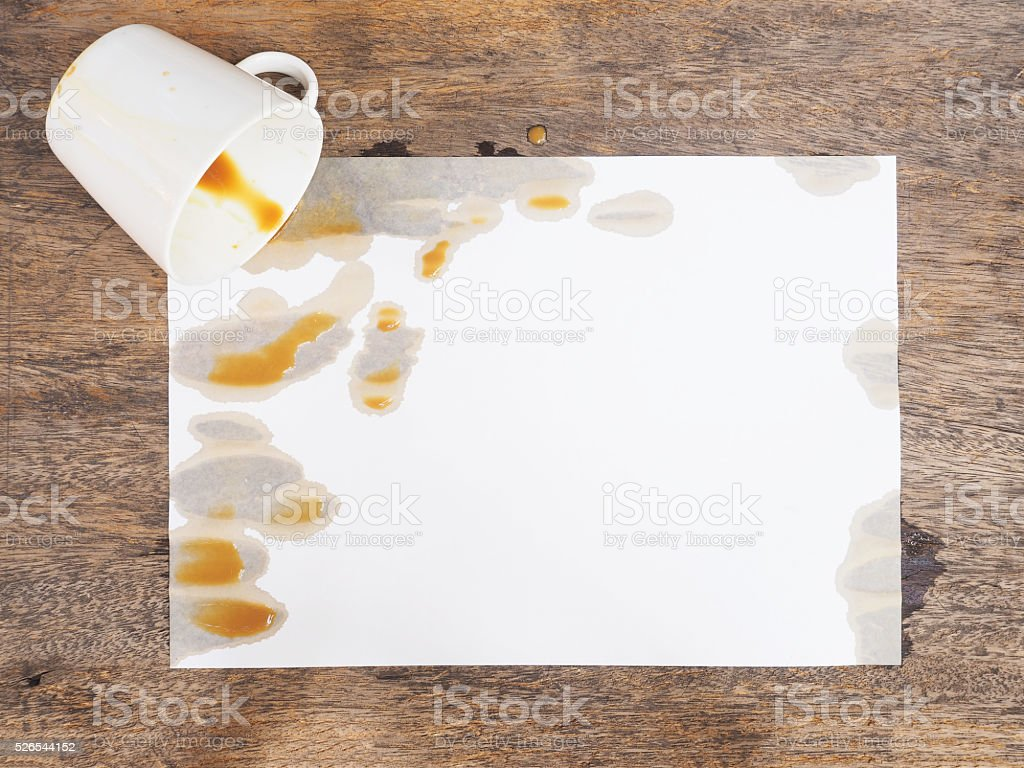coffee spilled out from white cup stock photo