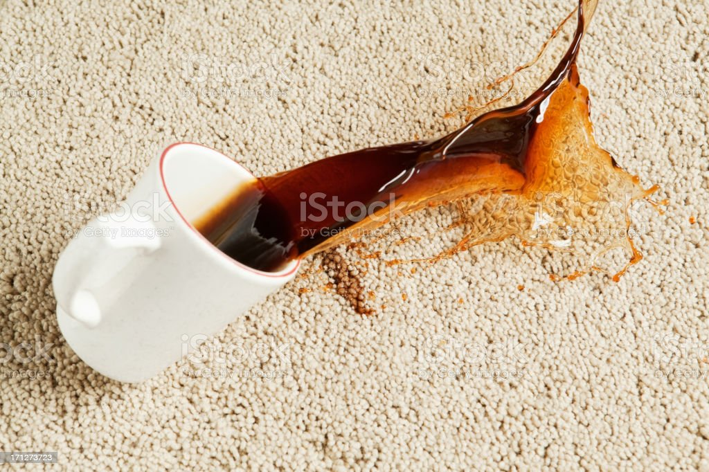 Coffee Spilling from Cup onto Carpet royalty-free stock photo