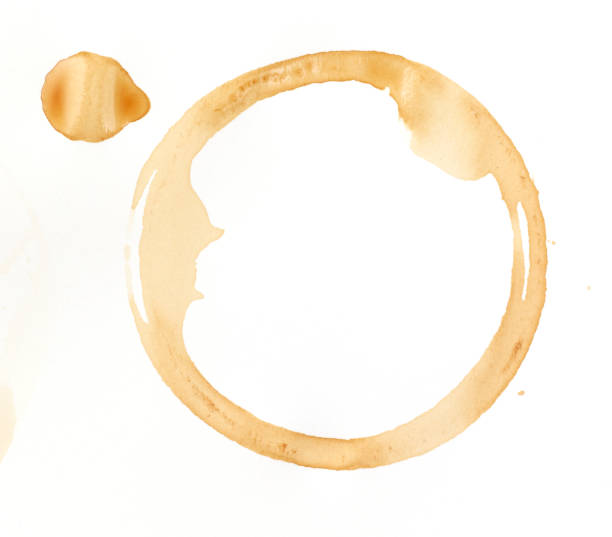 A coffee stain on a white background stock photo