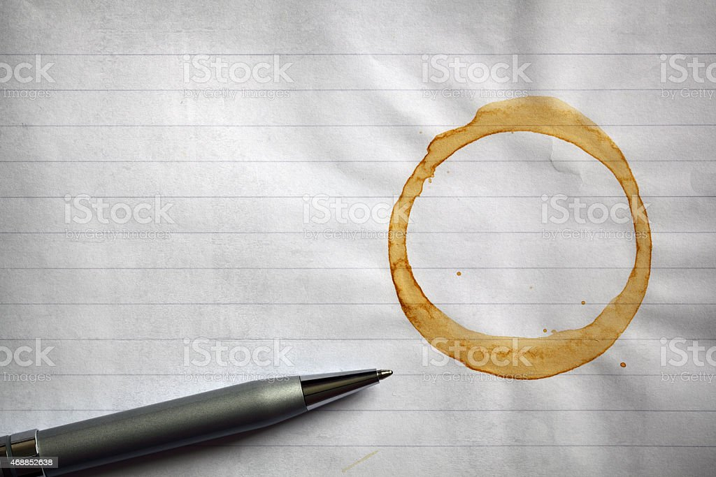 Coffee stained lined paper background stock photo