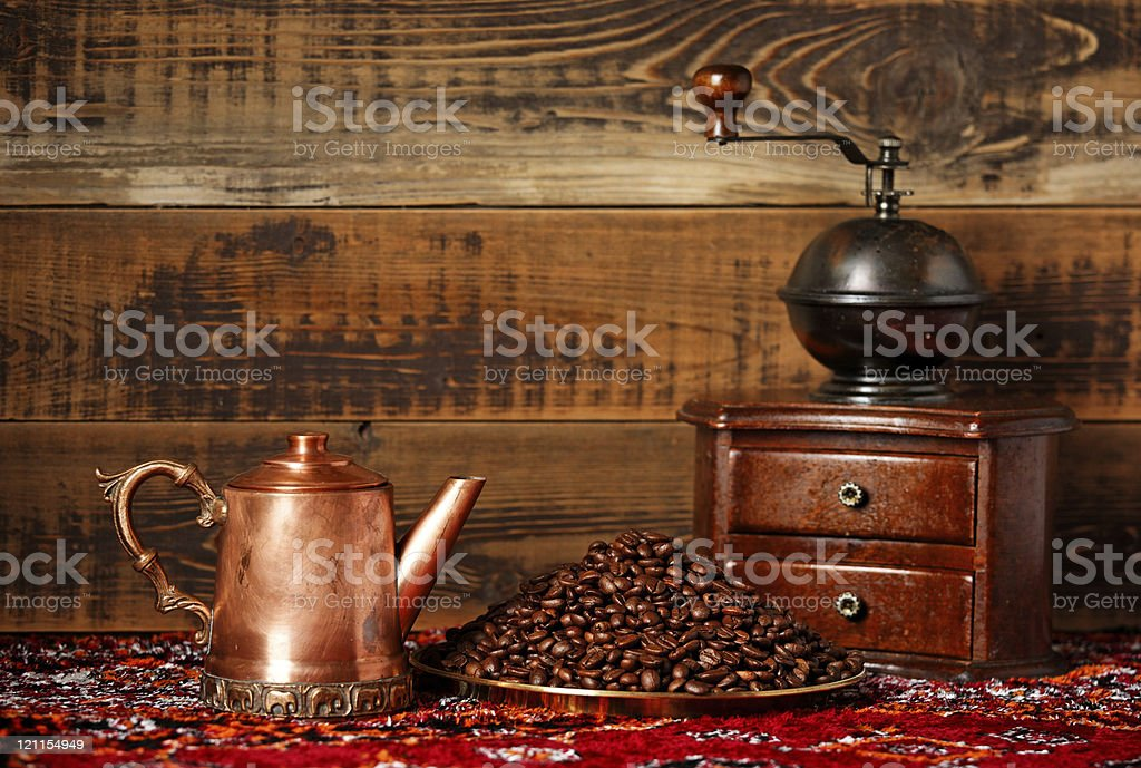 Coffee still life with beans and grinder royalty-free stock photo