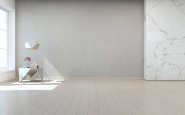 couchtisch auf holzboden mit weißem marmor und graue betonwand hintergrund große zimmer im modernen neubau, vintage fenster leeren saal oder natürliche lichtstudio. - betonboden wohnzimmer stock-fotos und bilder