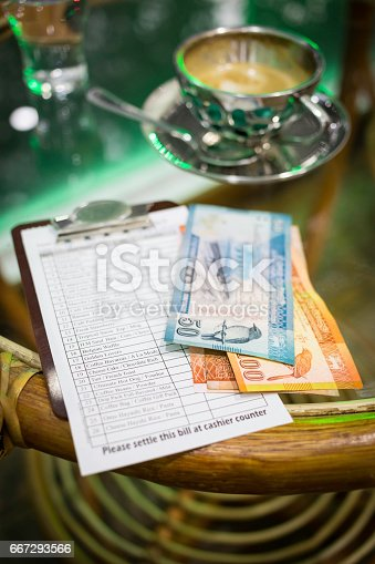 istock coffee table with a cup of cappuccino 667293566