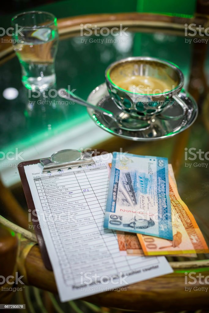coffee table with a cup of cappuccino stock photo