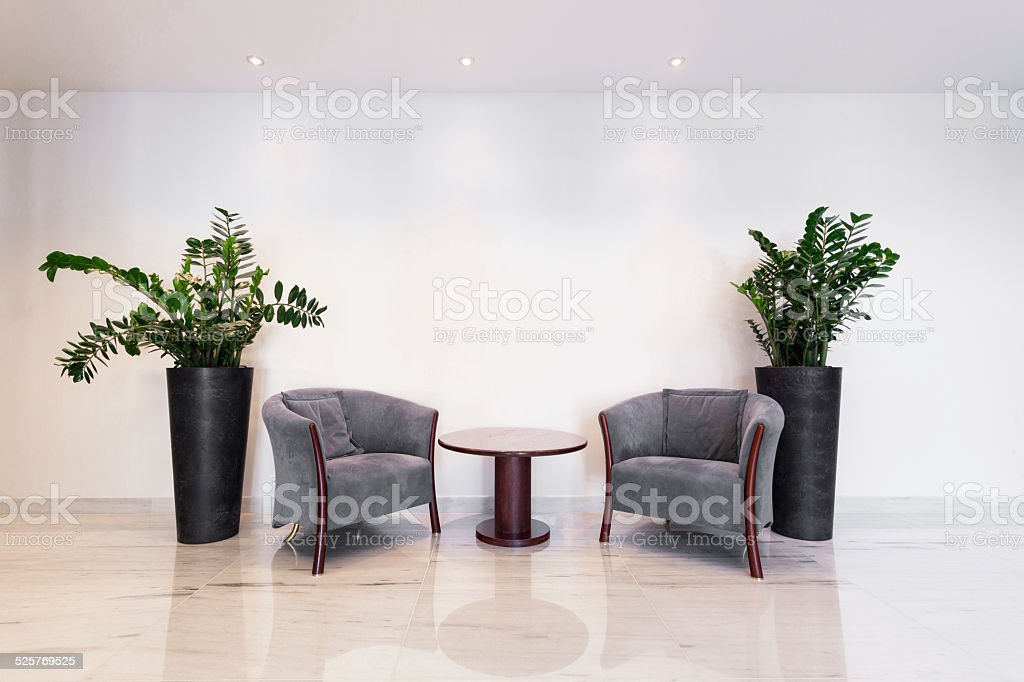 Coffee table with armchairs stock photo