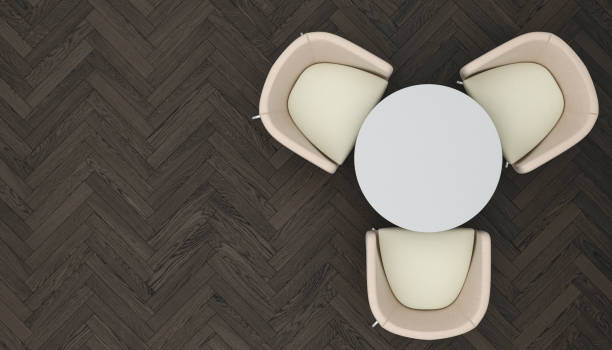 Coffee Table with Chairs on Chevron Parquet stock photo