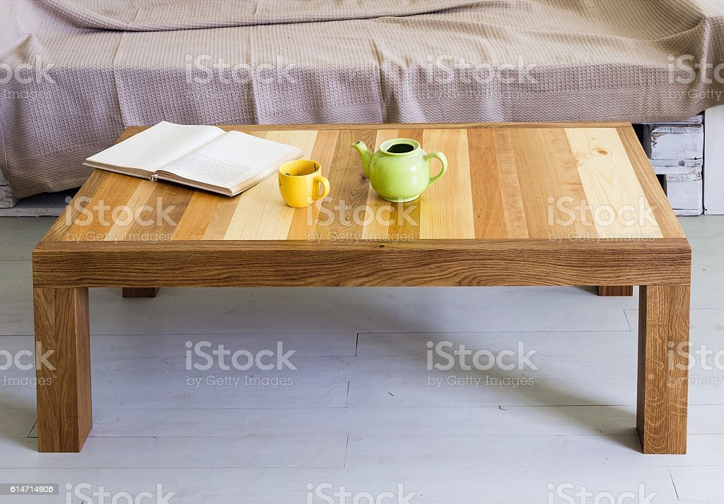Coffee table with top made of different kinds of wood stock photo