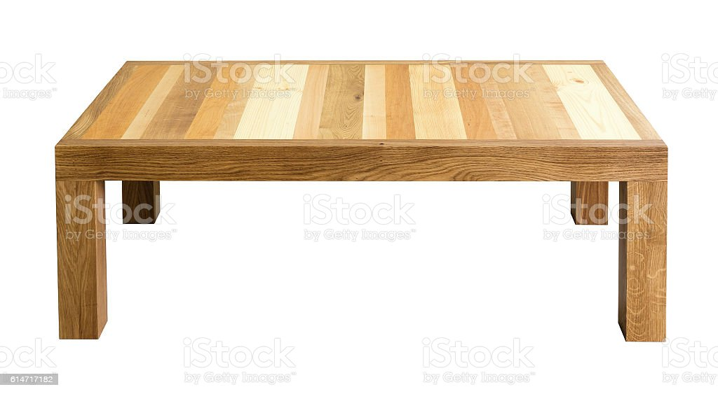 Coffee table with top made of different wood types stock photo