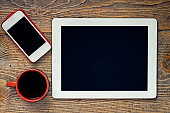 Coffee, Tablet and Smartphone on Wooden Table