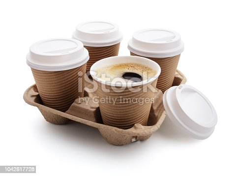 istock Coffee take out disposable cups in holder 1042617728