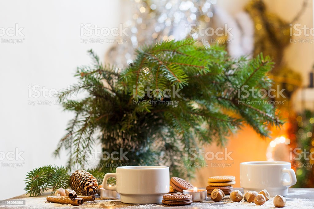 Coffee, tangerines, cookies and nuts in Christmas decor royalty-free stock photo
