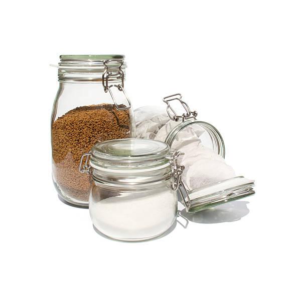 Coffee, tea and sugar in glass preserve jars stock photo