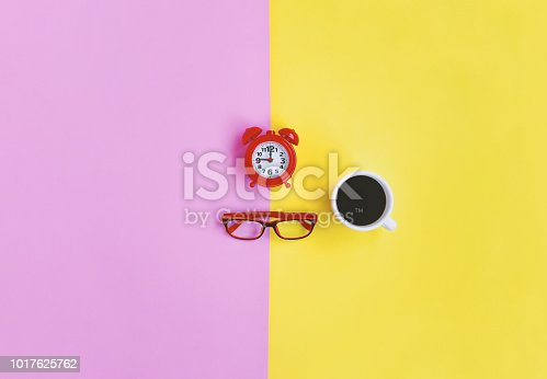 istock Coffee time in rush hour concept, alarm clock, eyeglasses and coffee with copy space 1017625762