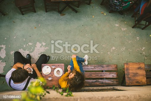 High angle view photography of Two Young people at the Cafe, Drinking Espresso