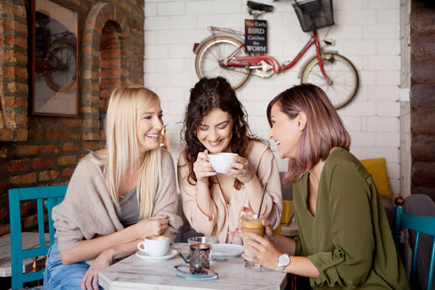 coffee time with girlfriends - women stock pictures, royalty-free photos & images