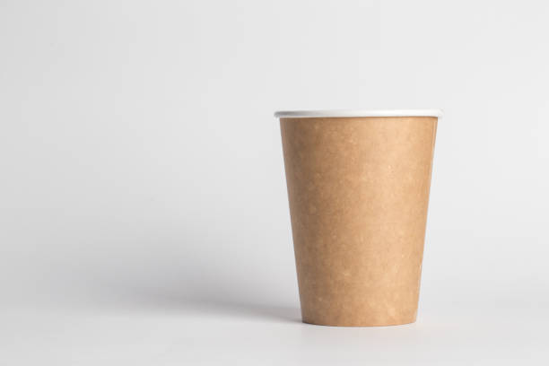 coffee to go in a disposable cup on a white background coffee to go in a disposable cup on a white background, place for text disposable cup stock pictures, royalty-free photos & images