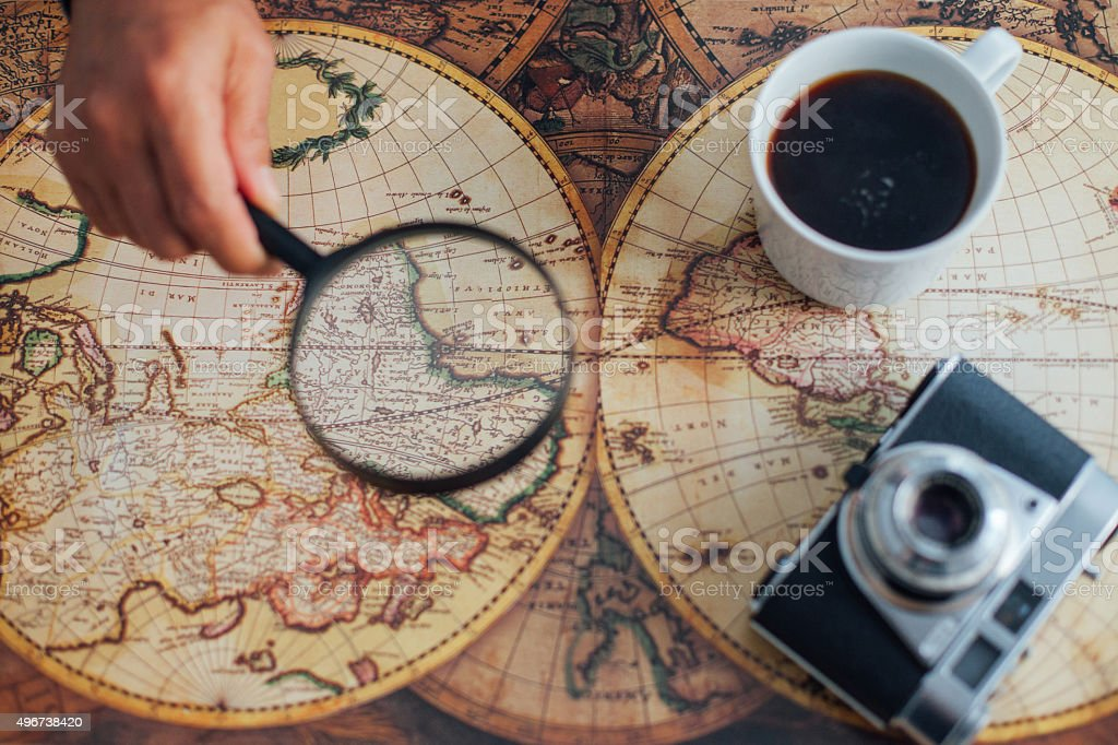 coffee, vintage camera, magnifier and world map stock photo