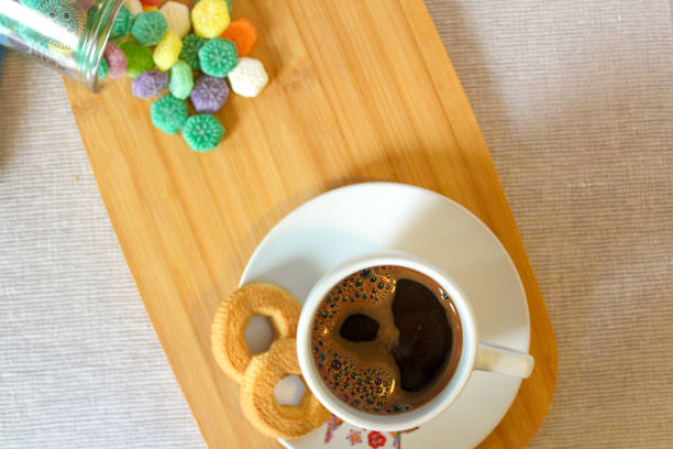 Coffee with cookies and candies stock photo