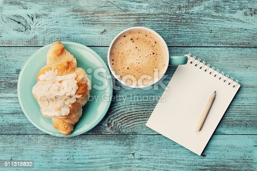 istock Coffee with croissant and notebook for business plan and design 511315832