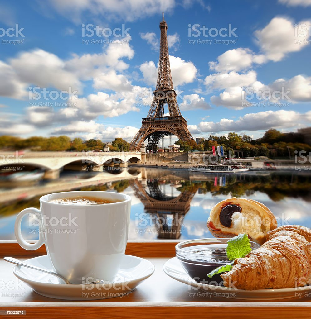 Coffee with croissants against Eiffel Tower in Paris, France stock photo