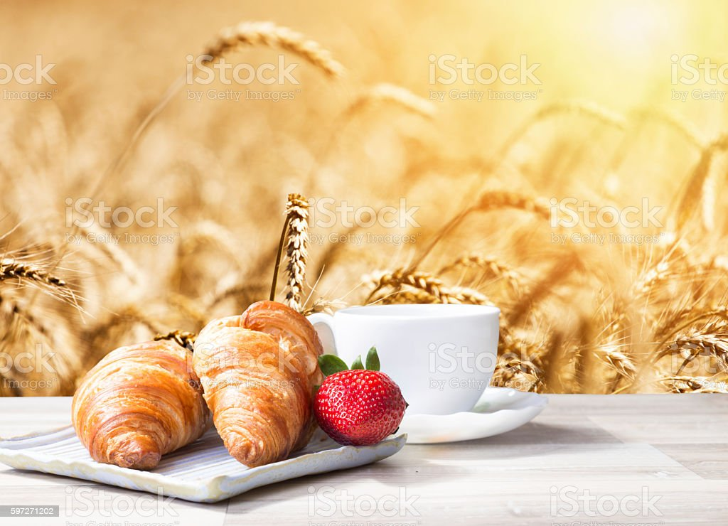 Coffee with croissants against wheat field Lizenzfreies stock-foto