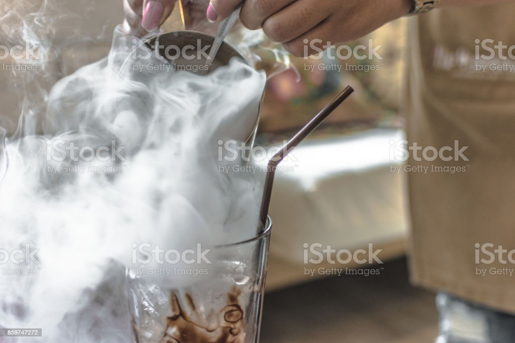 coffee with dry ice smoke at the cafe. stock photo