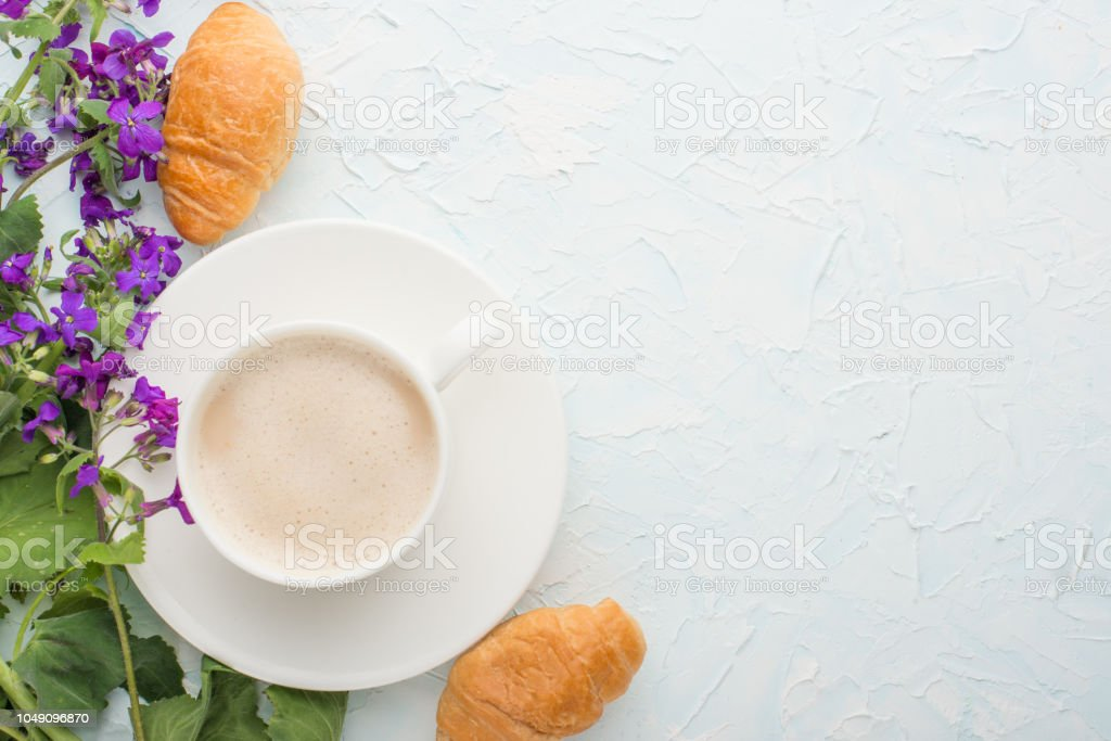 Coffee with flowers and croissants top view, with empty space for...
