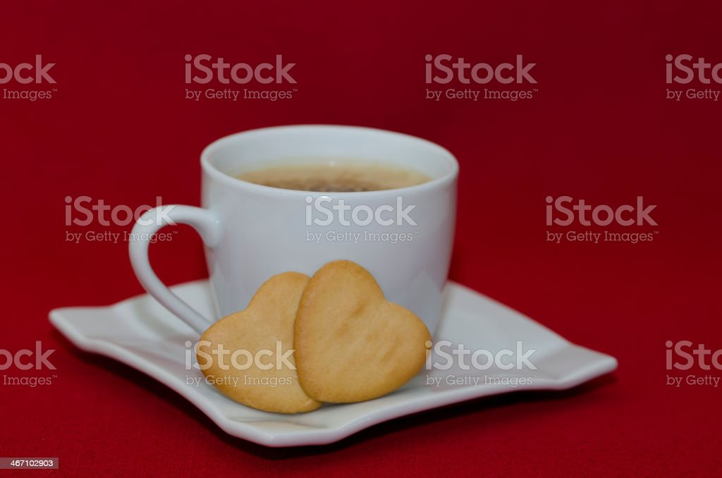 Coffee with Heart Shaped Biscuit royalty-free stock photo