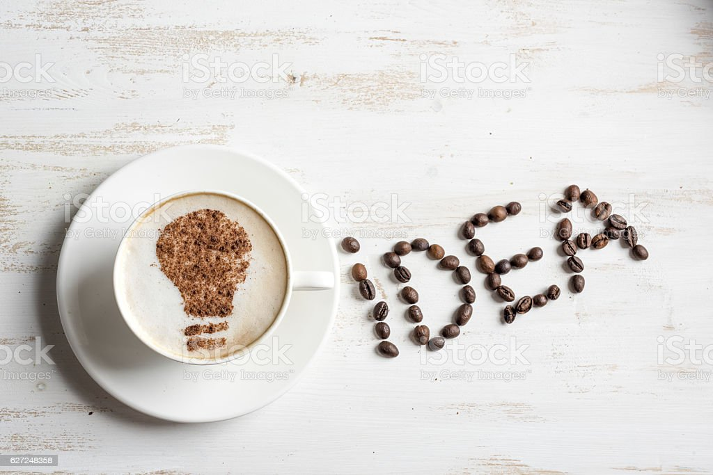 Coffee with lightbulb made of cinnamon. Brain storm or idea concept....