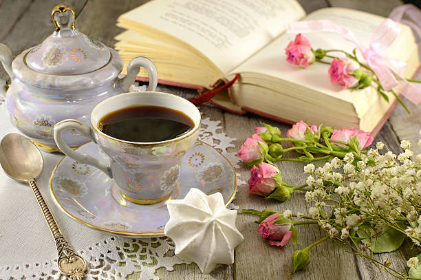 Coffee with meringues, roses and poem book stock photo