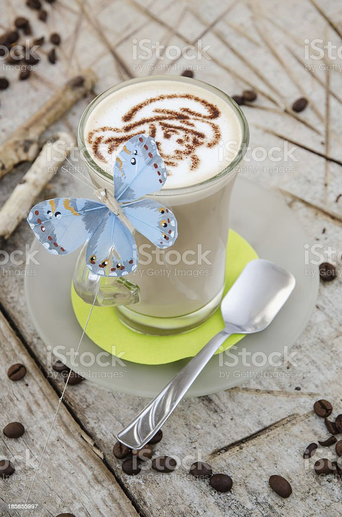 Coffee with milk on a wooden background