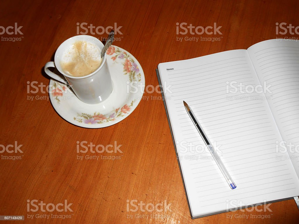 Coffee with notpad stock photo