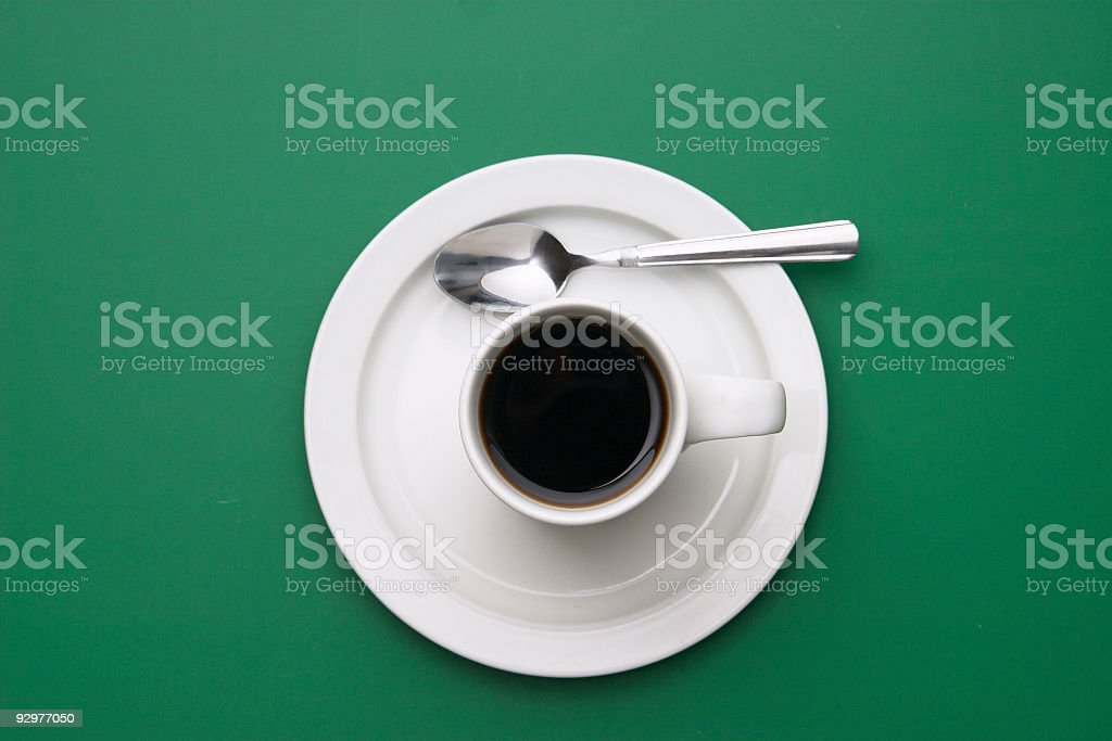 Coffee with Spoon on Green royalty-free stock photo
