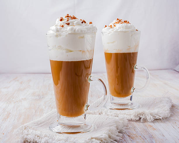 Coffee with whipped cream and chocolate stock photo