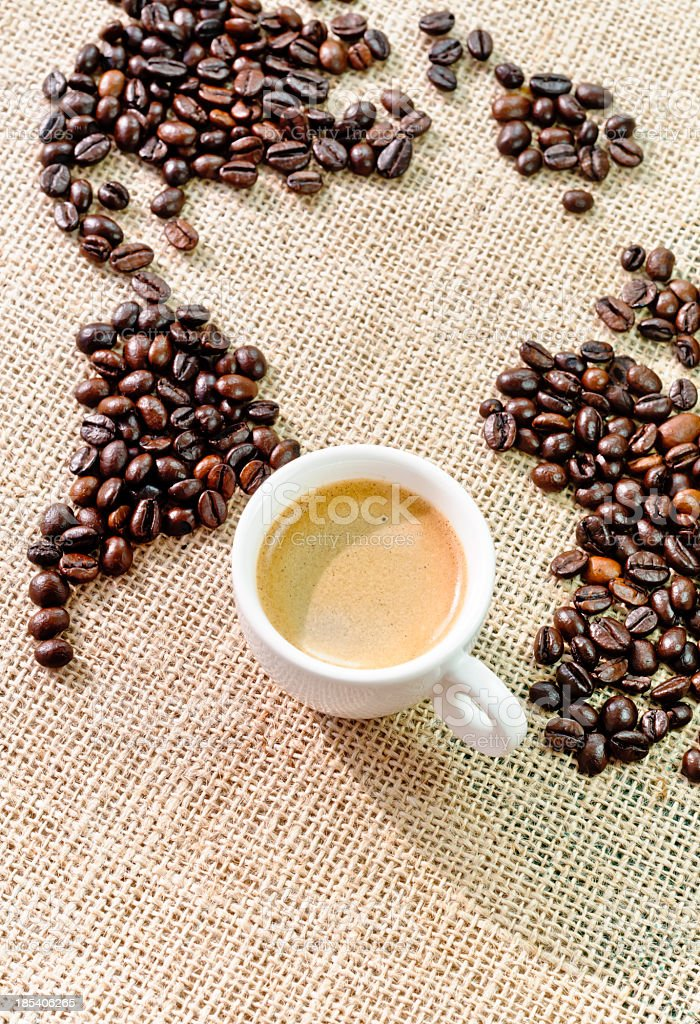 Coffee world map and cup of espresso royalty-free stock photo