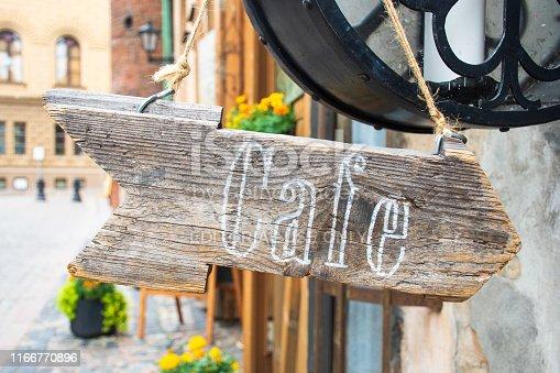 istock Coffee written on an arrow-shaped wooden base, old style, retro 1166770896
