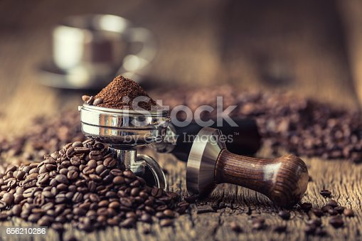 istock Coffee.Coffee beans and portafilter on old oak wooden table 656210286